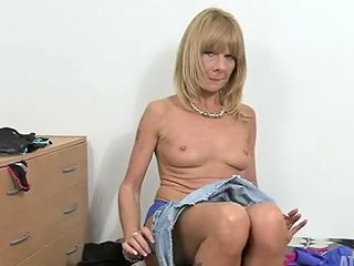 Freckled Mature Chick In A Sexy Black Blouse Strips Solo