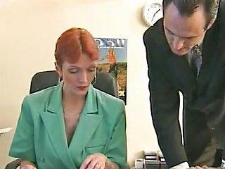 Redheaded Older Secretary Sucks Boss's Cock At Her Desk